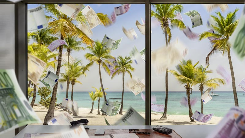 tax-haven-falling-money-beach-window-shutterstock_435518698-800x450